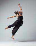 Beuatiful female dancer. Studio background. - 214983675
