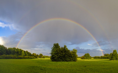 Rainbow after a thunderstorm over a road © were