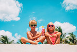sun protection- little boy and girl with suncream at beach - 214996648