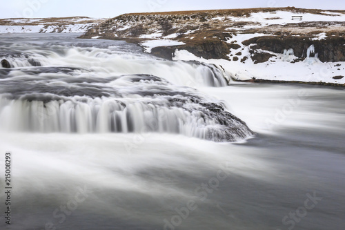Canvas Wit Ægissíðufoss waterfalls located near Hella at route 1, Iceland during Winter season.