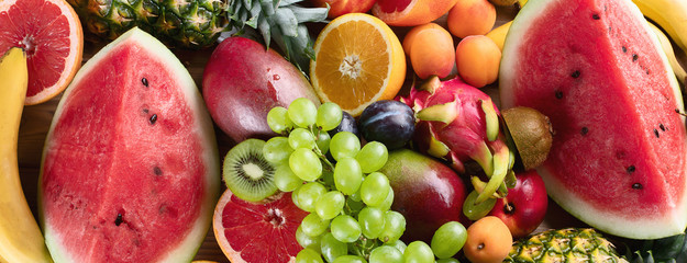 Healthy organic fruits background. © bit24