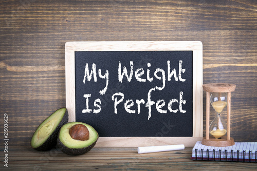 my weight is perfect. Fitness, healthy eating and veganism. Chalkboard on a wooden background - 215036629