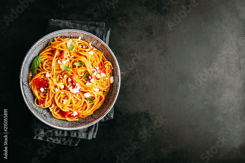 Italian pasta with tomato sauce in bowl - 215055891