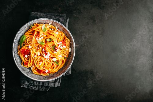 Italian pasta with tomato sauce in bowl - 215055891