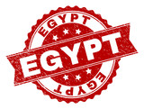 EGYPT seal print with corroded texture. Rubber seal imitation has round medal form and contains ribbon. Red vector rubber print of EGYPT caption with dust texture. - 215118660