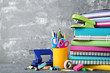 School supplies with books and notebooks on grey background