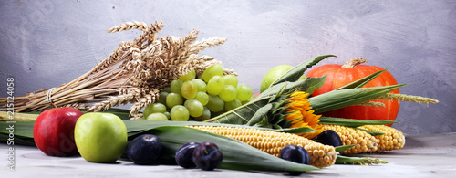 Autumn nature concept. Fall fruit and vegetables on wood. Thanksgiving dinner - 215124058