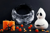 Halloween candy corns with pumpkin and spider on wooden table