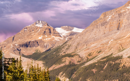 Foto Spatwand Zalm Great Rocky Mountains under magnificent clouds and sunlight, at Banff National Park, Calgary, Canada