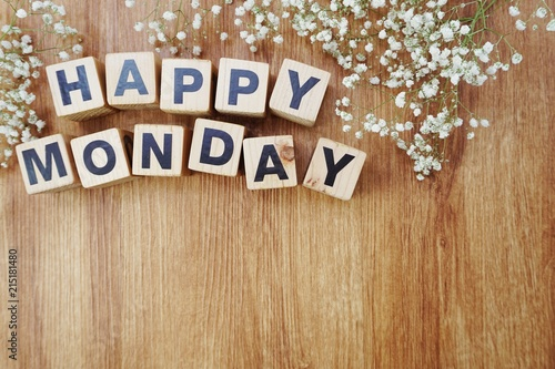 happy monday alphabet letters on wooden background