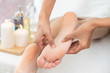 Leinwanddruck Bild - Foot spa massage treatment in luxury spa resort.