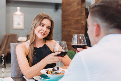 Beautiful couple in a restaurant - 215200636