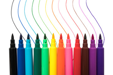 Colored markers with multicolor lines isolated on white background. School study art concept