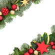 Quadro Christmas background border with red and gold star and ball bauble decorations, holly, fir, mistletoe and ivy isolated on white background.  Festive theme.