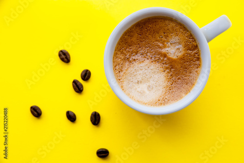 Cup of espresso and coffee beans, top view - 215220488