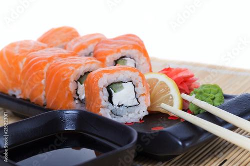 Foto Spatwand Sushi bar Salmon sushi rolls on a wooden background
