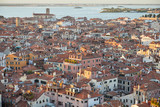 Elevated view of Venice with roofs buildings and sea before sunset, Italy