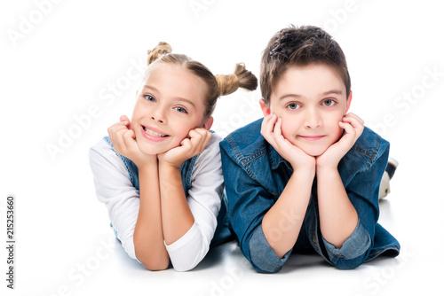 Leinwandbild Motiv two classmates resting chins on hands isolated on white