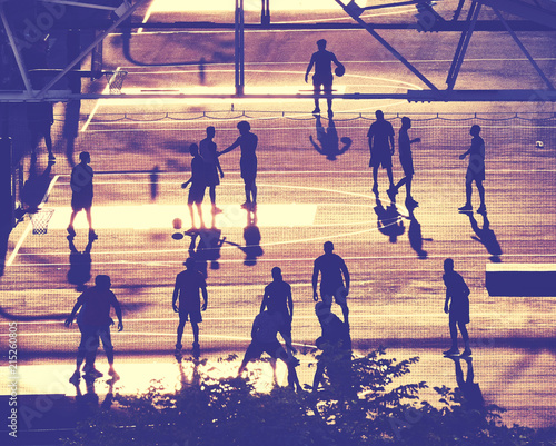 Foto Spatwand Basketbal Street basketball players silhouettes at sunset, color toning applied, New York City, USA.