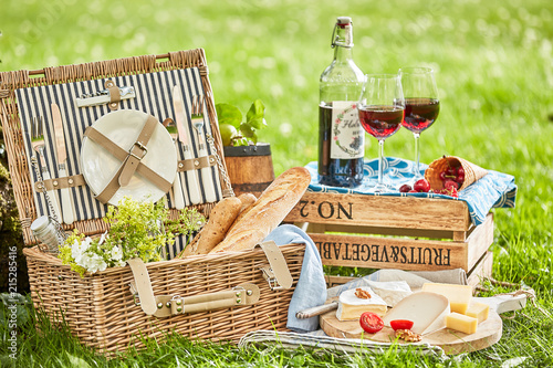 Foto Murales Picnic outside with a basket and delicious food