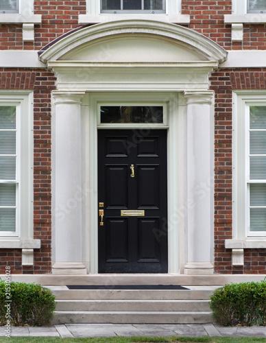 Elegant Front Door With Stone Frame