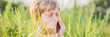 Leinwandbild Motiv Boy sneezes because of an allergy to ragweed BANNER, long format