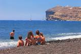 Greece, family enjoying at Black Beach, Santorini - 215348457