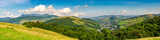 panorama of beautiful mountainous rural area. village down in the valley. agricultural fields on hills