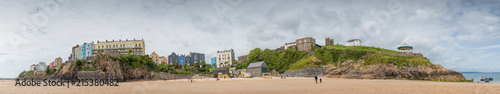 Panoramic view of Tenby from the beach adjacent to St Catherines fort, Pembrokeshire, UK - 215380482