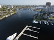 Excess and wealth expressed in large yachts docked along a waterway in Fort Lauderdale Florida