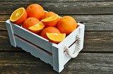Healthy and benefits of Orange..A lot of oranges in white wooden box on wooden background. - 215410458