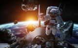 Astronaut working on a space station 3D rendering elements of this image furnished by NASA - 215420215