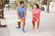 Couple training outdoors