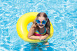 Leinwandbild Motiv Child on float in swimming pool. Kids sunglasses.
