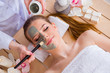 Leinwanddruck Bild - Young woman in spa health concept with face mask