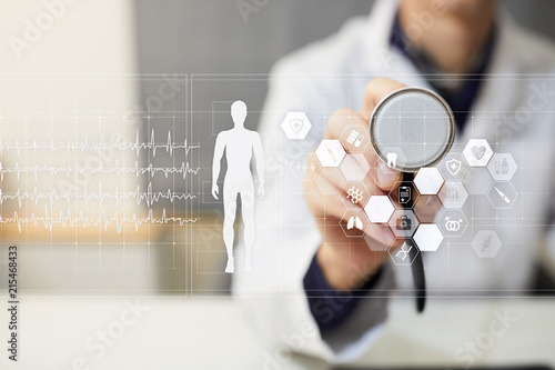 Foto Murales Doctor using modern computer with Medical record diagram on virtual screen concept. Health monitoring application.