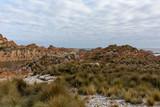 Orange rocks at West Point State reserve, Tasmania, Australia