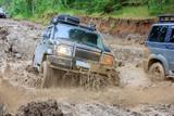 Mud bath for an SUV traveling through the taiga