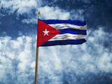 Cuba flag Silk waving flag of Cuba made transparent fabric with wooden flagpole gold spear on background sunny blue sky white smoke clouds real retro photo Countries of world 3d illustration