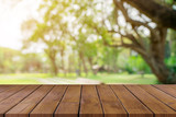 Empty wooden table top and green bokeh display montage for product with space. - 215479698