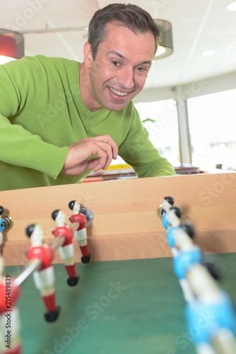 Fotobehang Voetbal man playing on the football table