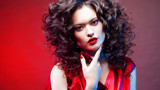 Voluminous hair. portrait of a beautiful young woman with red lipstick