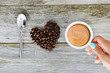I love coffee quote with natural coffee beans in heart shape on a wooden kitchen table