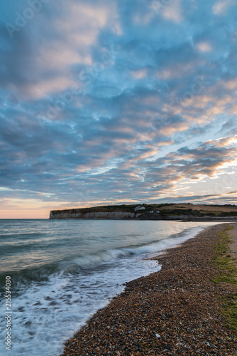 Aluminium Blauwe jeans Stunning colorful dramatic Summer sunset over Seven Sisters landscape in Englad