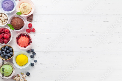 Leinwanddruck Bild Ice cream with nuts and berries