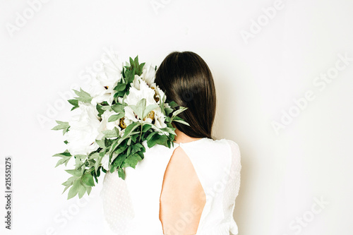 Young woman holding white peonies bouquet on white background. - 215551275