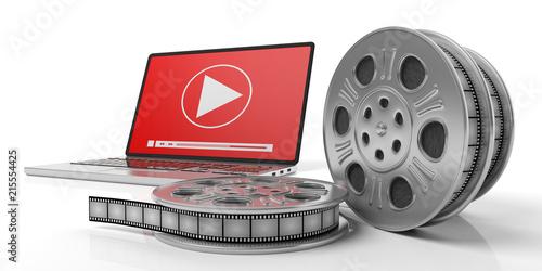Leinwandbild Motiv Film movie reels and a laptop on a white background, isolated, 3d illustration.
