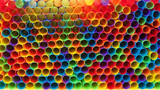 Hundreds of colorful plastic straws laying facing forwards opening towards viewer, laying on yellow surface. Many cities are now banning single use plastic straws. - 215556626