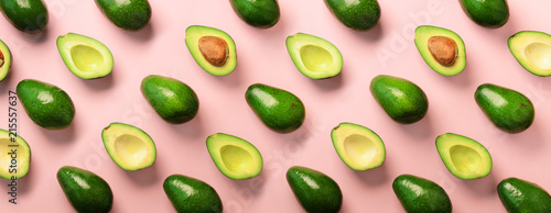 Avocado pattern on pink background. Top view. Banner. Pop art design, creative summer food concept. Green avocadoes, minimal flat lay style. Banner - 215557637