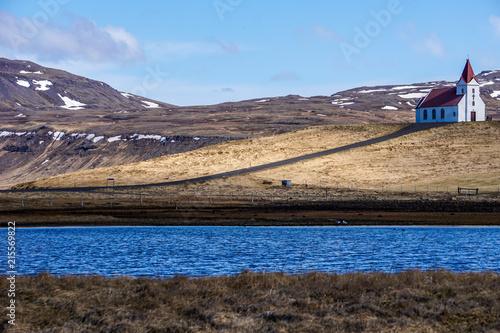 Foto Spatwand Blauwe hemel White church between Rif and Hellissandur in Iceland
